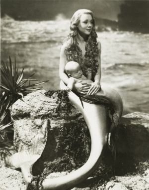Miranda 1948 British starring Glynis Johns In the final scene, Miranda is shown on a rock, holding a little merboy on her lap.