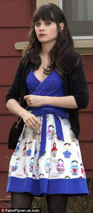 blue dress and skirt adorned with Russia Babushka dolls