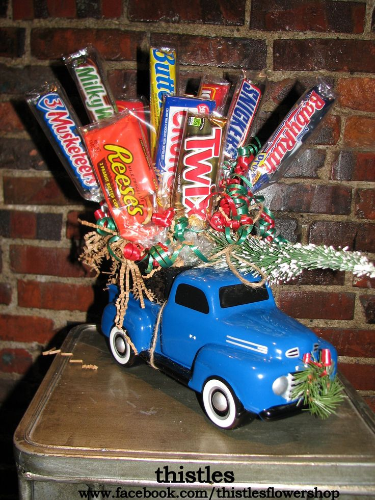 A candy bar bouquet in the bed of a pickup truck bring home a Christmas tree.