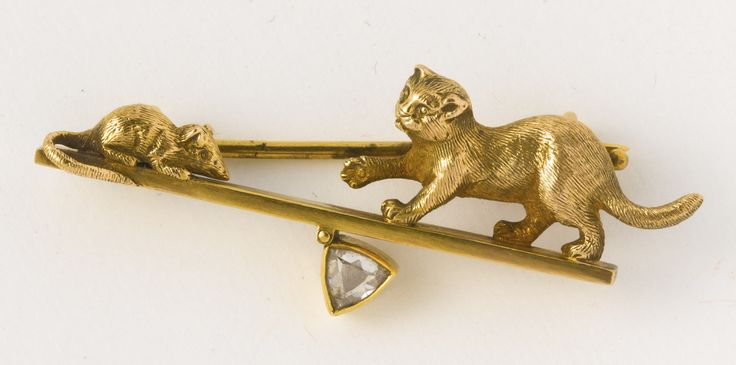 A Russian jeweled gold brooch, workmaster Carl Blank, Hahn, St. Petersburg, circa 1895, in the form of a cat and mouse, with diamond pendant, 56 standard, contained in original fitted leather case