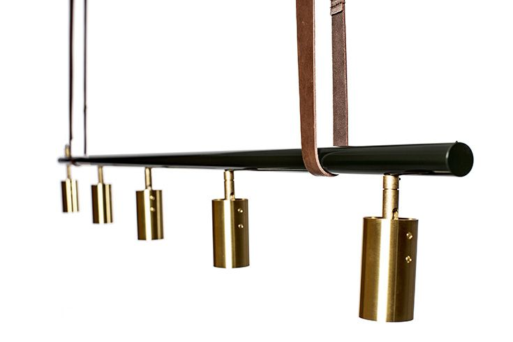 The Long John pendant light by Rubn in bottle green and with brass shades.