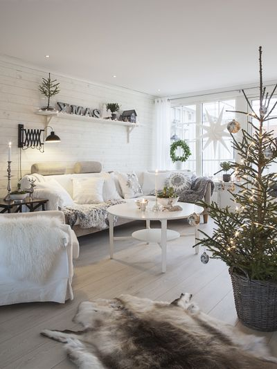 I'm not attracted to the all-white, but there's something so beautiful about this room. And I love the potted Xmas tree.