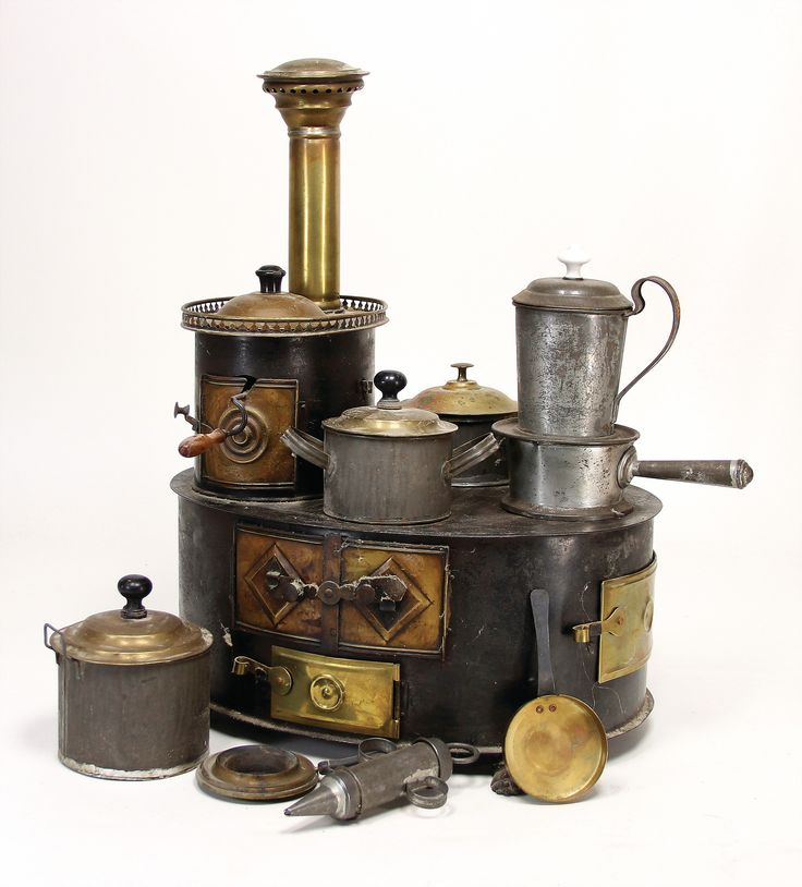 probably MÄRKLIN museum dollkitchen stove, c. 1870, width: 38 cm, height: 50 cm, circular, tinplate, brass doors in the front and also at the side and in the back, lion's paw feet, body with coffee roaster at the top , 3 tinplate pots with brass cover, 1 cover isn't original, certainly from a stately household, nice decoration for an early doll, all pots original and suitable?