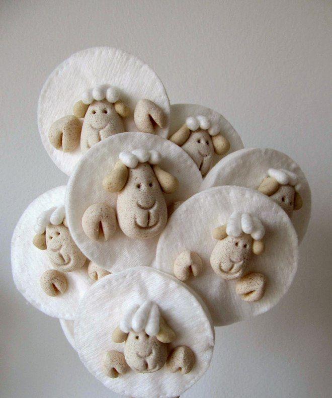 sheep faces made of salt dough glued on a cotton pads