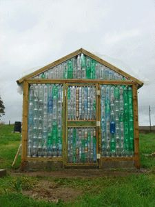 Recycled bottle greenhouse. Beautiful colors! ok all those wine bottles will have