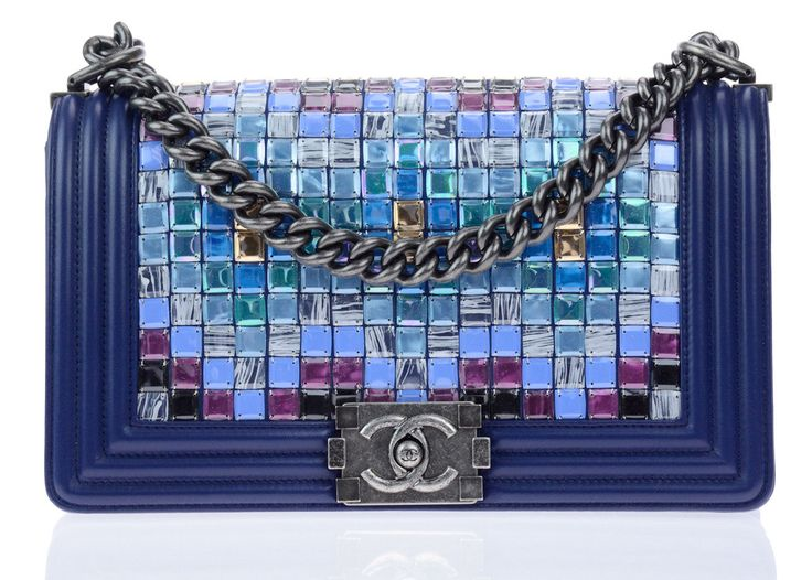 Chanel Runway Blue Multicolor Lambskin Medium Boy Bag With Mosaic Embroideries By Lesage. Chanel Runway Blue Multicolor Lambskin Medium Boy Bag With Mosaic Embroideries By Lesage is from the Fall 2015 Collection! This flap bag is a truly striking piece with gorgeous embellishments. The tiles are featured in tones of blue, green, gold, purple, black, and printed all in a unique pattern embroidered by Lesage. The blue lambskin leather really emphasizes the mosaic tiles.