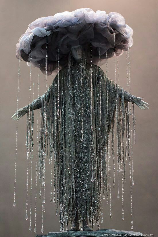 Form- the forms of the hat, the dress, and water droplets are used in this costume to illustrate a rain cloud,