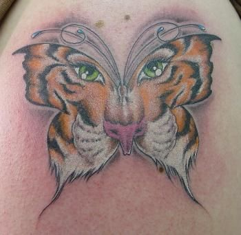 tattoos big cats | terrible cat tattoos: big cat edition | World Wide Whiskers