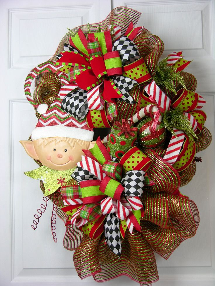 A sweet metal elf paired with peppermint accents is on this large deco mesh…
