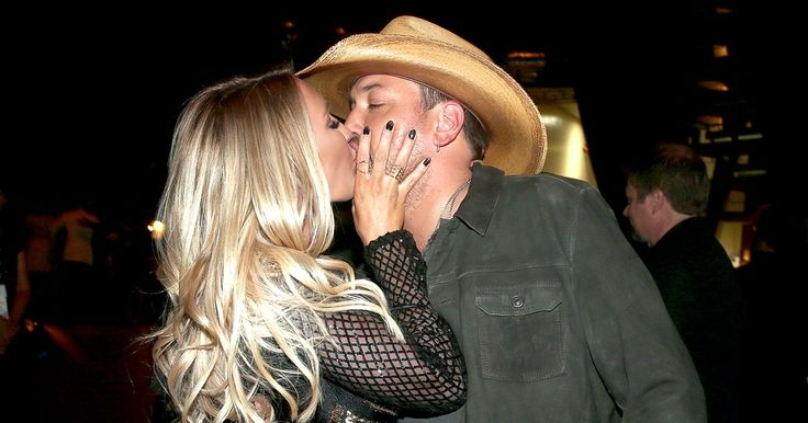 Country superstar Jason Aldean kissed his wife of one year, Brittany Kerr, before accepting the Entertainer of the Year honor at the 2016 ACM Awards on Sunday, April 3 — watch the lovey dovey moment here