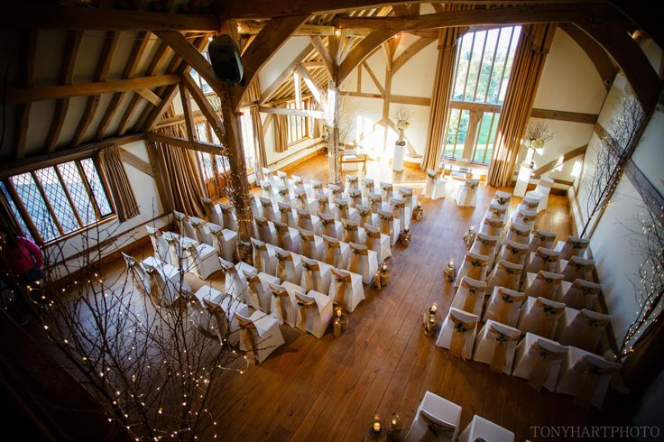 Lauren chose a stunning rustic woodland theme for her winter wedding at Cain Manor. Fir cones, hessian, evergreen branches, white roses and candles on log plinths. Seriously good looking.  ©TonyHartPhoto  cain_manor_wedding_laurendan-002