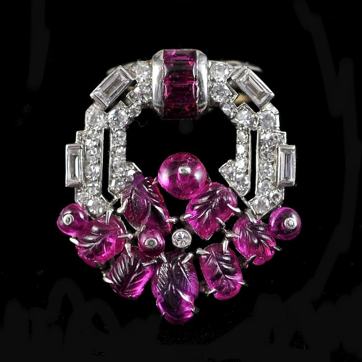 TUTTI FRUTTI CLIP BROOCH MAUBOUSSIN Country: France Period: Art Deco Art Deco Tutti Frutti Clip Brooch Platinum and white gold, set with diamonds in different cuts and carved rubies Signed: Mauboussin France Ca. 1925