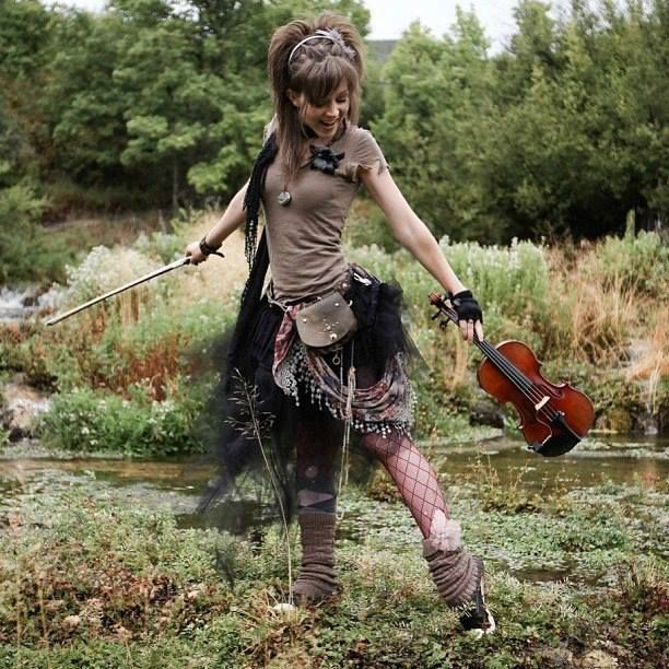 Lindsey Stirling... The only modern artist that prefers to over dress in layers than be under dressed and over exposed.