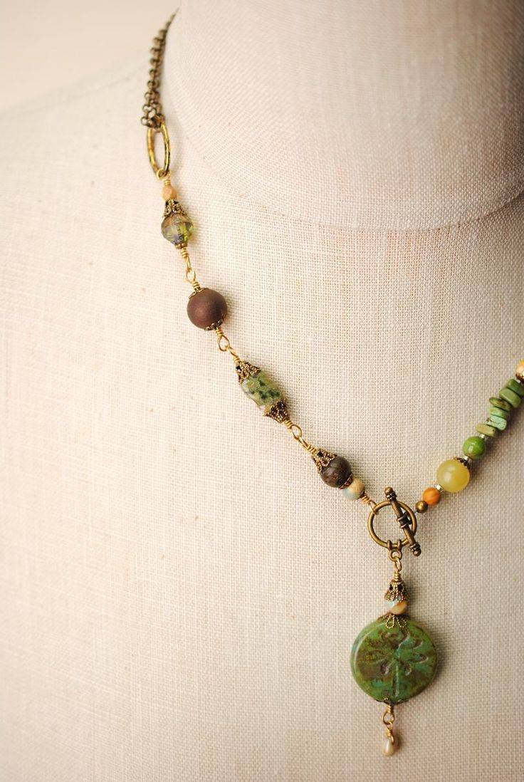 This handmade chunky layer necklace for women features a gorgeous collage of Czech glass with natural gemstones, finished with a pressed handmade glass dragonfly pendant! The Rustic Creek line is one