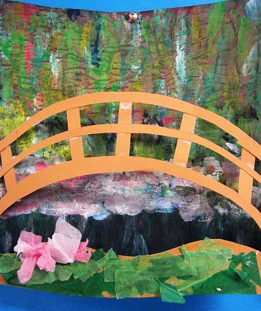 Monet's Bridge    This was a really fun lesson. The class painted a background with impressionistic paint adding a bridge and base of card and tissue paper, stretched and attached to the edges. Causing the background to curve
