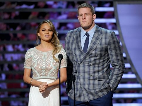 Chrissy Teigen, left, and J.J. Watt, of the Houston Texans, present the AP offensive rookie of the year award on stage at the 4th annual NFL Honors at the Phoenix Convention Center Symphony Hall on Saturday, Jan. 1, 2015. (Photo by Frank Micelotta/Invision for NFL/AP Images)