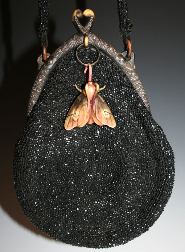 1930's Black Beaded Evening Bag with a Celluloid Moth dDecoration .....