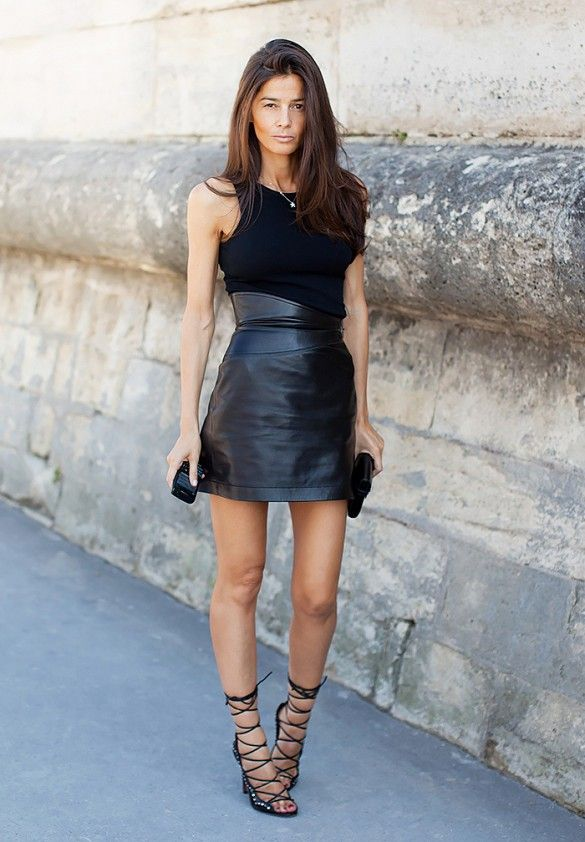 Asymmetrical high waisted leather skirt coordinating with strappy heels.