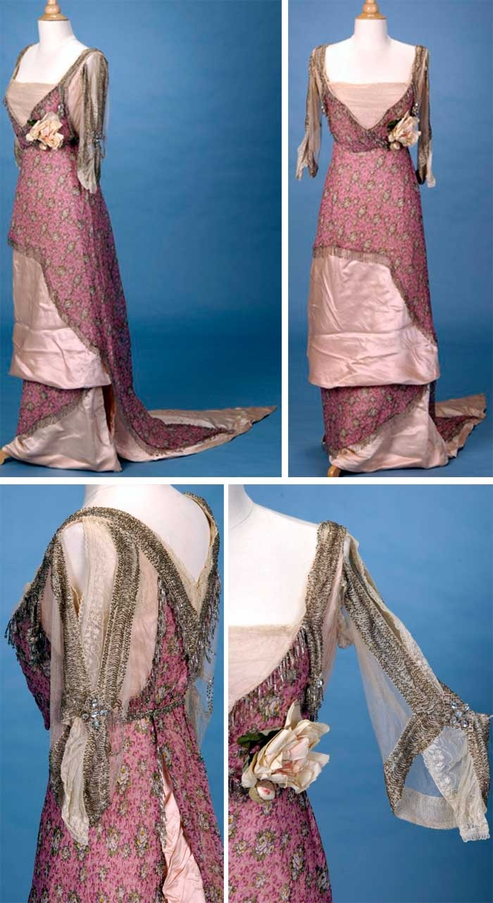 Dress, Agnes Unwin, London, ca. 1912. Rose printed chiffon draped asymmetrically over light pink underskirt. Beaded bodice with modesty insert of pleated pale pink tulle. Tassels at both sides of the bust are accented with paste stones. Original faux floral corsage at Empire waist. Internal bodice has boning at waist and drawstring ribbon neckline. Lace sleeves with beading. Pointed train. Trousseau.net via web.archive.org