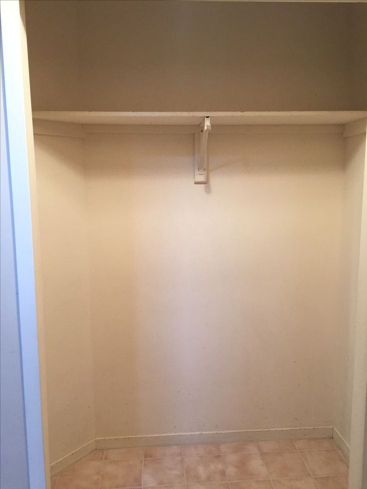 Before picture of the entry coat closet makeover.