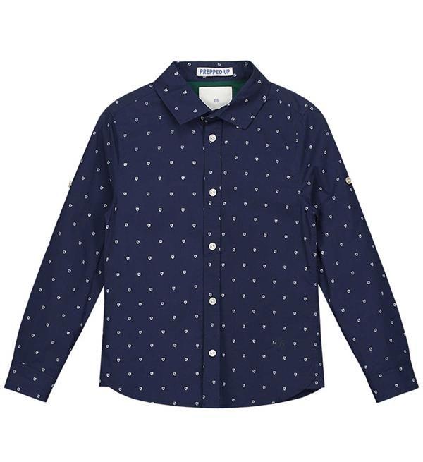 Nik and Nik blouse Omid met all over print. Deze blouse heeft lange mouwen en een knoopsluiting.    Dit item komt uit de Nik and Nik jongenskleding  collectie najaar 2017-2018. Shop Nik & Nik jongenskleding online @  https://www.nummerzestien.eu/nik-and-nik/jongens/