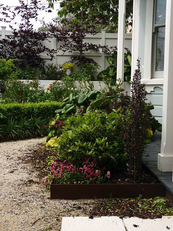 "Berberis ""Helmond Pillar"" & the Copper Beech picking up the rust tones of the corten steel | A garden for all seasons ~ Beauchamp, HEDGE Garden Design & Nursery"