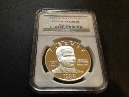 1998-S Black Patriots Ultra Cameo Silver Dollar features Crispus Attucks on the obverse of the coin