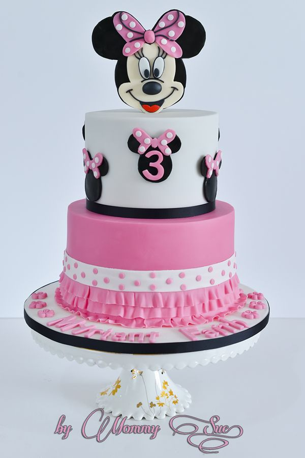 2 Tier cake with standing Minnie Mouse head topper
