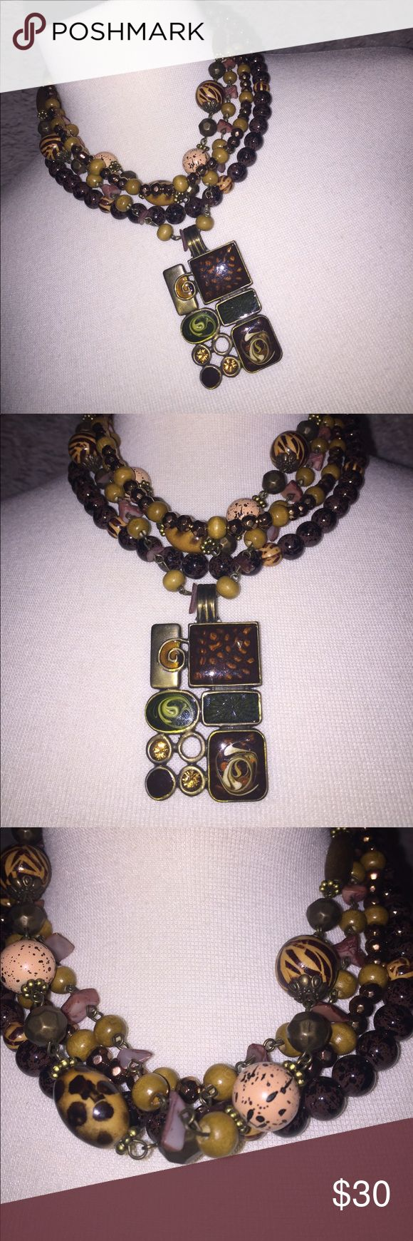 Premier Designs Necklace AND Detachable Pendant This multi-strand necklace is gorgeous in green, browns and animal print beads. Looks great alone or with the pendant (included) which has magnetic detaching clasp so can easily be worn with other necklaces. Premier Designs Jewelry