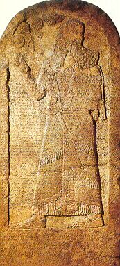 This limestone monument, known as the Kurkh Monolith, is apporximately seven feet high and is now located in the British Museum.  Discovered in 1862 in Kurkh, Turkey, it was originally carved in c. 850 BC by the Assyrians.  The cuneiform text refers to a battle involving King Ahab of Israel, who is also frequently referred to in the Bible (cf. 1Kings).