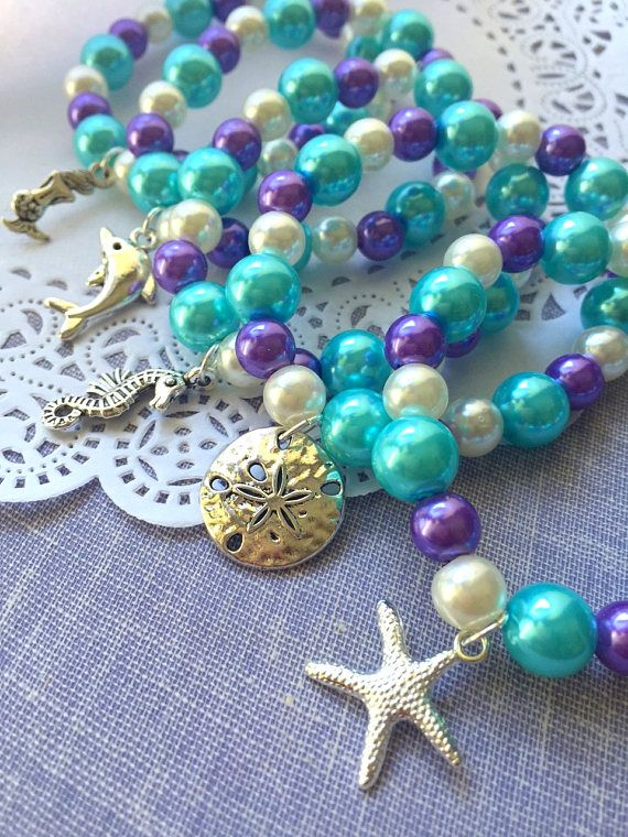 Mix charm set, Under the sea birthday party, kids party favor, beaded bracelet, mermaid, dolphin, starfish, sanddollar. SET of TEN. ****************** Party planning is already so stressful. Leave the favors up to us! This listing is for (10) bracelets, please let us know if you need more or less and we can make you a custom listing. DETAILS and MEASUREMENTS: Beads vary in sizes from 6mm-10mm. The length of a bracelet is 6.5 (we can make them smaller or bigger for you). COLOUR & CHAR...
