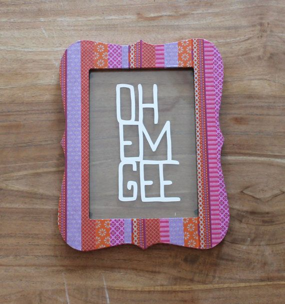 "Papercut art quote in an unique colorful frame; ""OHEMGEE""."