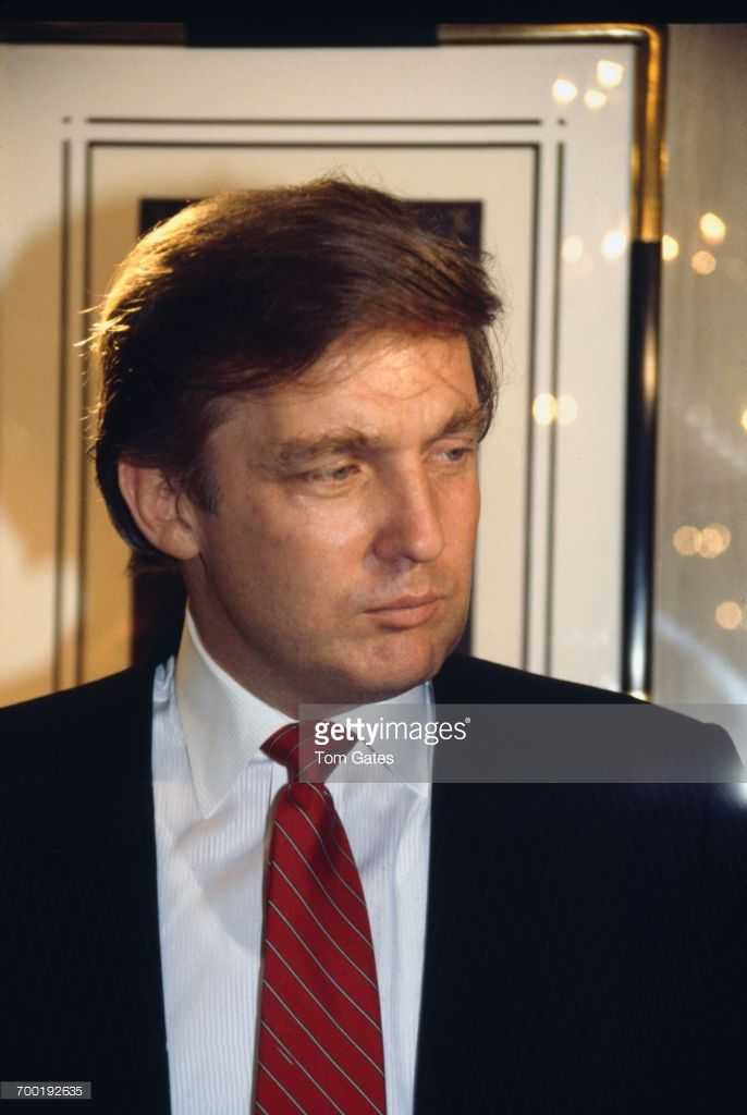 American real estate magnate Donald Trump at a party held at the Circle Gallery in Trump Tower, New York City, December 1987. The event marks the 95th anniversary of the artist Erté and the launch of a new line of his alphabet jewellery.