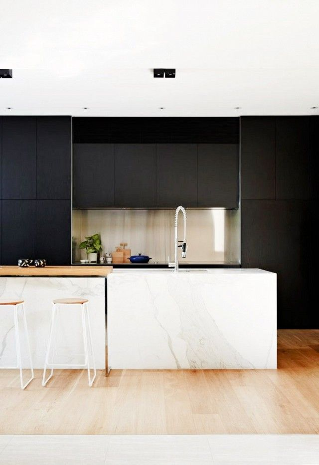Paired with clean black elements, high-contrast white marble makes a striking impact.