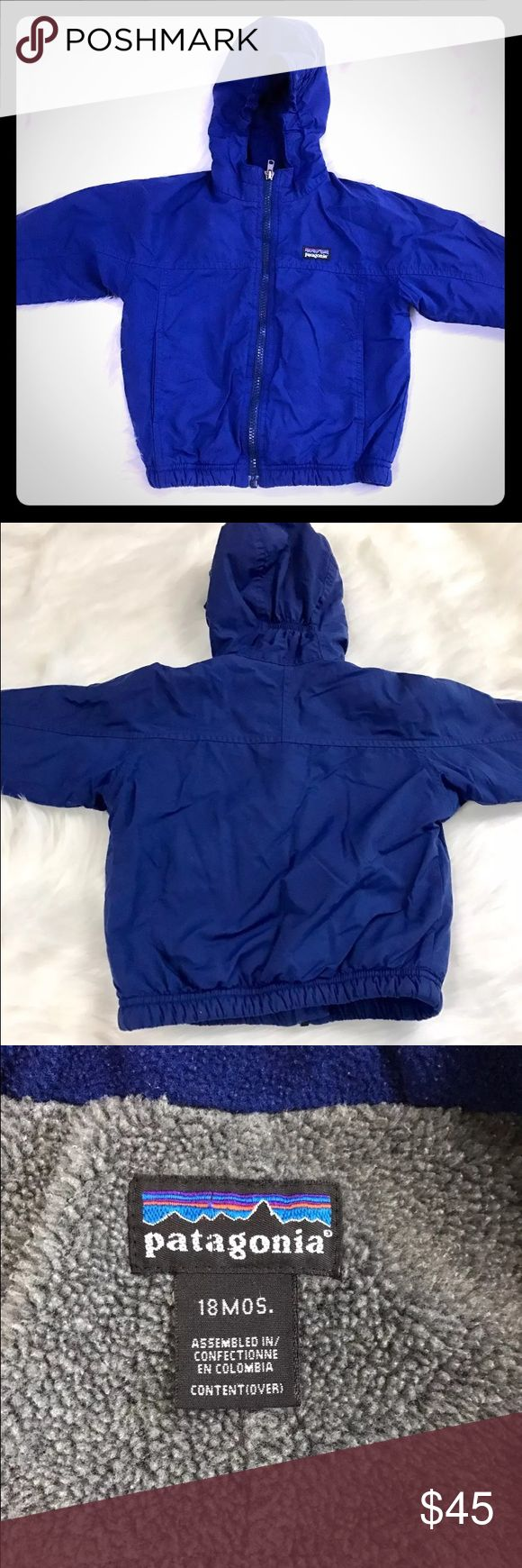 Patagonia Baby Fleece Lined Jacket Adorable Patagonia Baby Fleece Lined Hooded Jacket.  Thick pile fleece inside to keep baby warm and cozy. Lining 100% Polyester. Shell: 100% Nylon.  Gently worn. Name tag has name written on it but can easily be covered with name sticker. Patagonia Jackets & Coats
