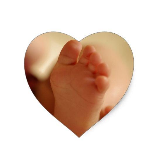 Close up photo of baby feet heart sticker