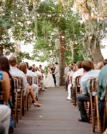 Simple strings of light at this daytime wedding added an ethereal elegance to the outdoor ceremony.