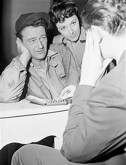 Laraine Day Watches John Wayne at Chess Pictures | Getty Images