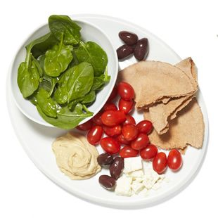 Aim for 300 to 350 calories for lunch. Lunch is a great time to get in healthy, fiber-filled, low-calorie vegetables, lean protein and whole grains. Try this Mediterranean Plate: assemble a 4-inch whole-wheat pita bread, 1 ounce of feta cheese, a cup of grape tomatoes, 6 Kalamata olives, 2 tablespoons hummus and a cup of raw spinach with 1 teaspoon of olive oil and a squeeze of lemon juice drizzled on top. That's 346 calories.