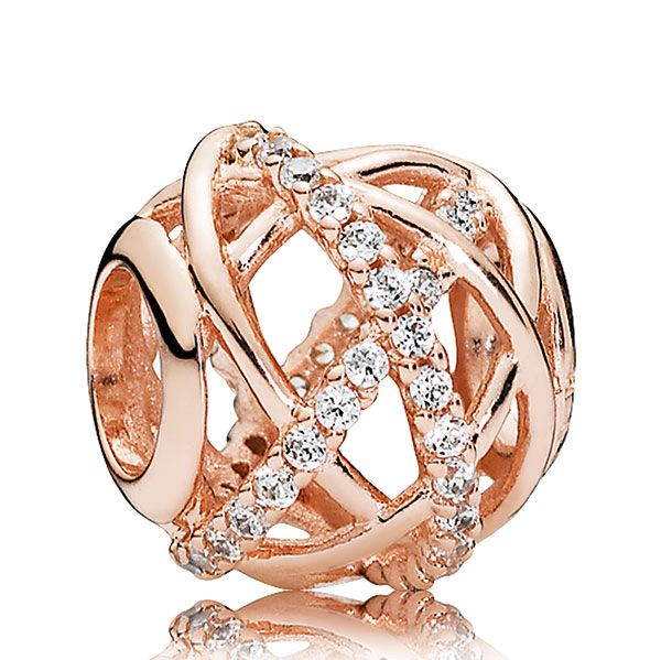 This intricate charm resembles a beautiful, rosy galaxy – crossing lines of stars in the form of sparkling cubic zirconia stones orbit its center and create a beautiful decorative effect.<br><br><i>Luminous and elegant, PANDORA Rose™ jewelry combines a unique blend of metals to capture new and unforgettable moments in warm pink-hues.</i><br> <br>  <b> Style: </b> 781388CZ