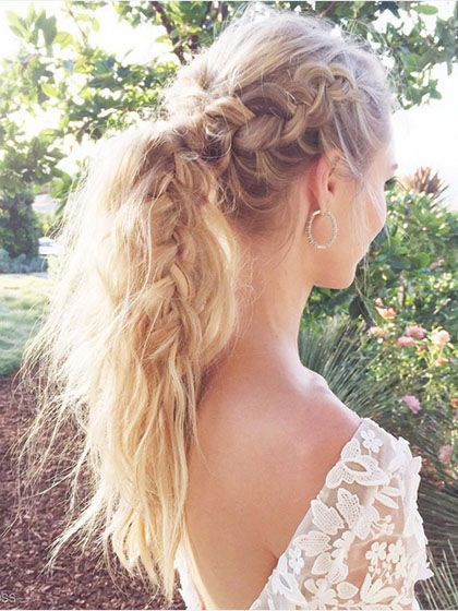 After you complete a Dutch braid (a reverse French braid) down one side, go in with some dry shampoo and gently pull it apart. This will create a thick-looking braid. And after the ponytail is secure, use your fingers to back-comb the tail slightly
