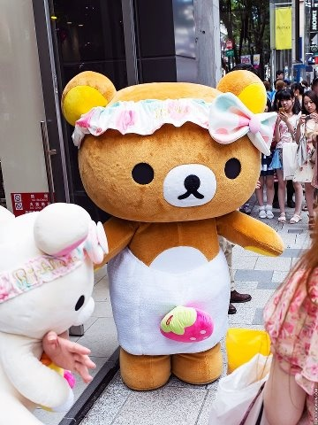 Have you seen Rilakkuma?  ☆リラックマ☆    This cute bear is one of the most popular characters in Japan, mostly among teenage girls.  It showed up in Harajuku apparently in the cute strawberry dress.