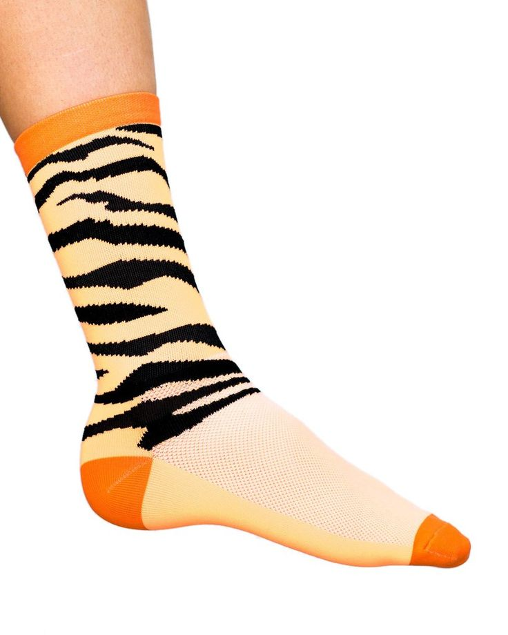 Cycling socks with tiger stripe with an orange sock base.  #Cosmicsocks #cyclingsocks #sockporn #showusyourkits #sockheight #sockgame #sockdoping #socks #cyclegear #cyclinggear #kitporn #kitwatch #cyclestyle #cyclechic #kitspiration #cyclists #cycling #outsideisfree #roadcycling #cyclist #cyclinglife #roadcycling #instacycling #lovecycling #instacycle #cyclinglove #instabicycle #cyclistlife #cycleclothing #malvernstar #steelisreal⠀