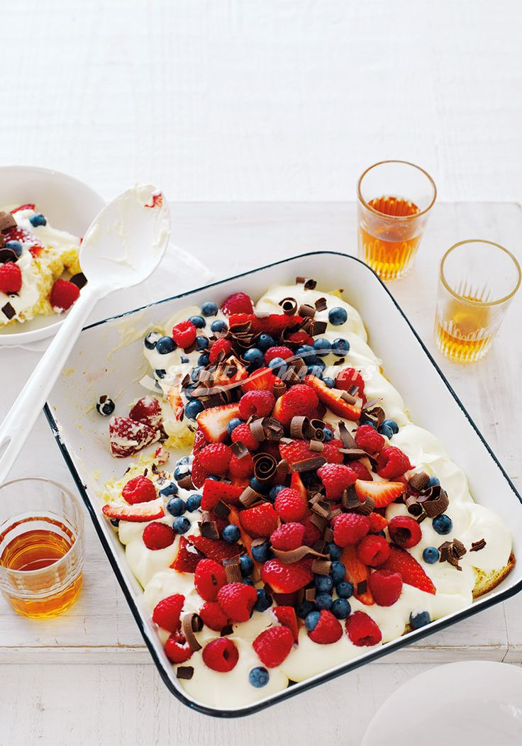 Prep 25 mins | Serves 6-8 Add a splash of orange liqueur to the orange juice if desired.  500g panettone* 1⁄3 cup fresh orange juice 600ml cream 1 tbs icing sugar 1 tsp vanilla extract 250g raspberries 250g strawberries, halved lengthways 150g blueberries Grated or shaved dark chocolate  *Panettone is Italian style brioche bread sold in some greengrocersand supermarkets.  Step 1 Remove crusts from panettone and cut into 1cm-thick slices. Line base of a 25cm x 28cm enamel or ceramic baking…