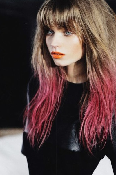 Pink hair, coral lips.