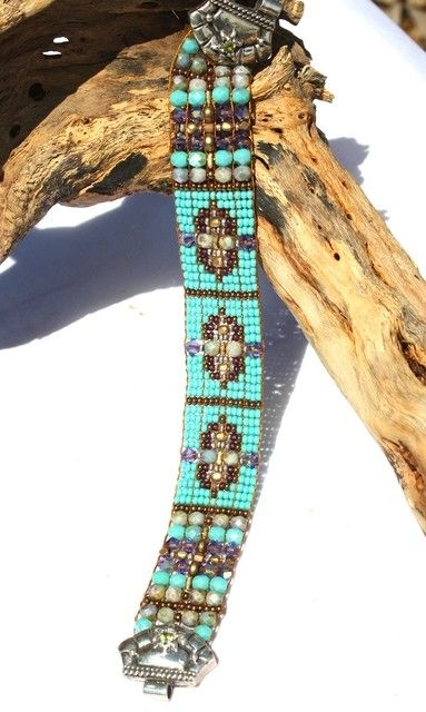 Chili Rose Beaded bracelets-beaded cuff, western jewelry, cuff, hand beaded http://www.cowgirlkim.com/chili-rose-extraordinary-black-rust-and-turquoise-beaded-bracelet-8928.html