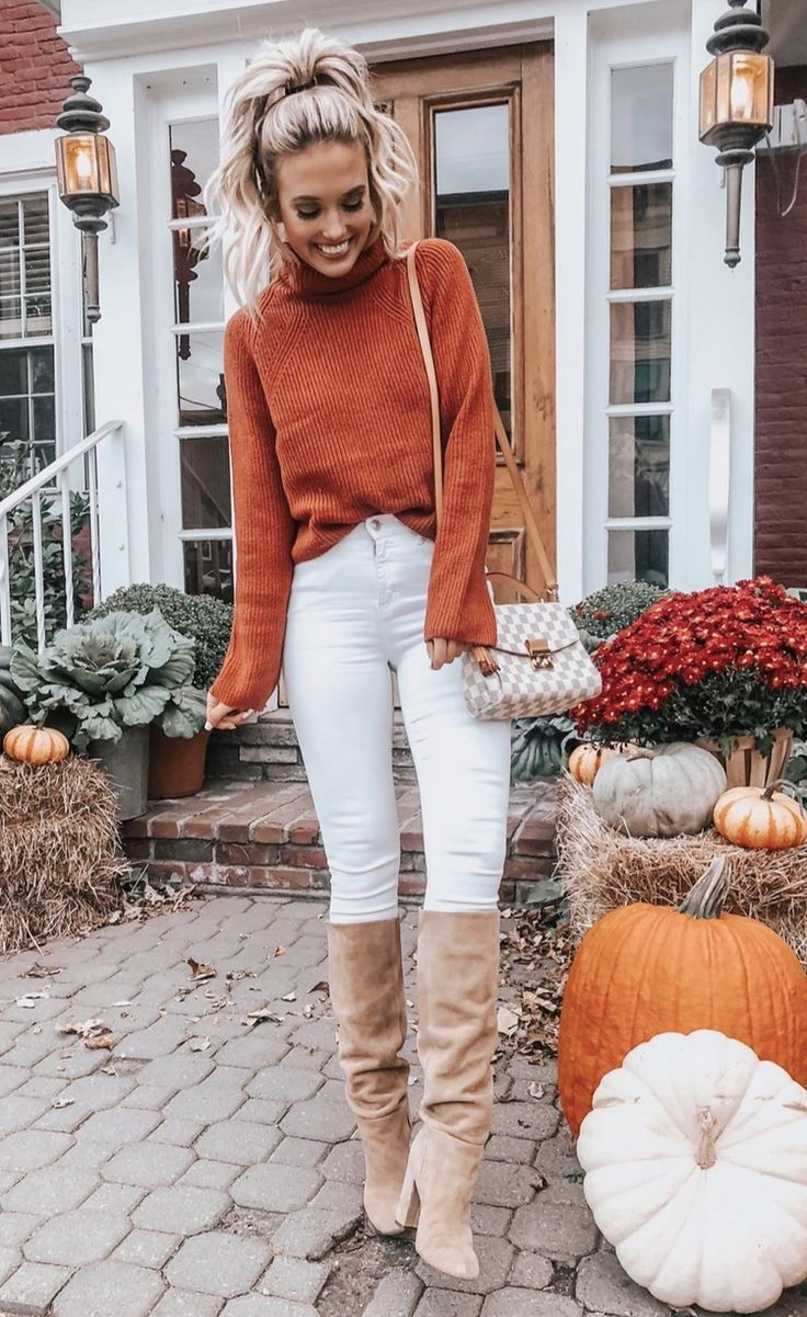 21  Winter Outfits To Copy ASAP: Colorful orange sweater with white jeans. These casual winter outfits will keep you warm when other cold weather outf…