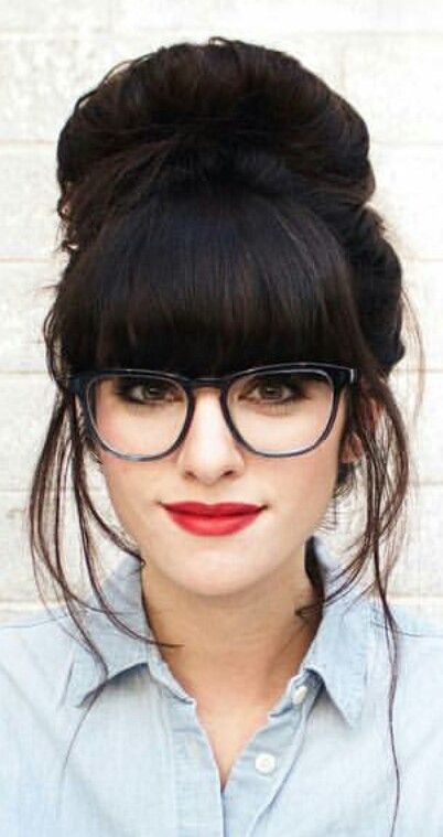 Love the combination of a denim shirt, dark hair and red lipstick with a cool fringe