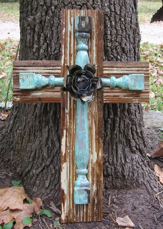 Cross made with scrap wood and chippy painted spindle - so awesome!  It's an Etsy item but could easily be DIY'ed...