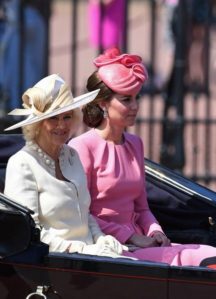 Britain's Camilla, Duchess of Cornwall (L), Britain's Catherine, Duchess of Cambridge travel in a horse-drawn carriage past Buckingham Palace on their way to Horse Guards Parade for the Queen's Birthday Parade, 'Trooping the Colour', in London on June 17, 2017....The ceremony of Trooping the Colour is believed to have first been performed during the reign of King Charles II. In 1748, it was decided that the parade would be used to mark the official birthday of the Sovereign. More than 600…